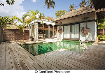 panoramic view of nice tropical villa with pool