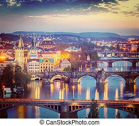 Vintage retro hipster style travel image of travel Prague concept background - elevated view of bridges over Vltava river from Letná Park. Prague, Czech Republic in twilight