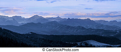 Panoramic view of Rocky mountains in evening time