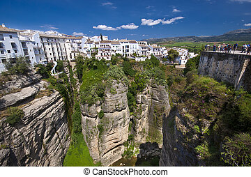 Panoramic view from a new bridge in Ronda, one of the famous white villages in Andalusia, Spain