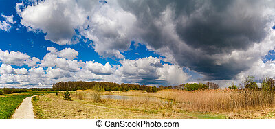 Panoramic view of rural landscape, sunny spring day