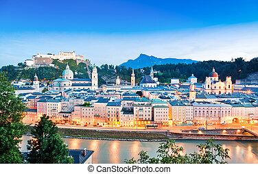 Panoramic view of Salzburg skyline with river Salzach at dusk as seen from Kapuzinerberg in Salzburg, Salzburger Land, Austria