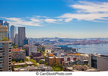 Panoramic view of Seattle downtown and mountain Rainer looming o