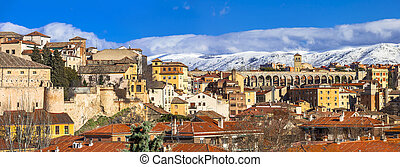 panoramic view of Segovia with aqueduct and mountains, Spain...