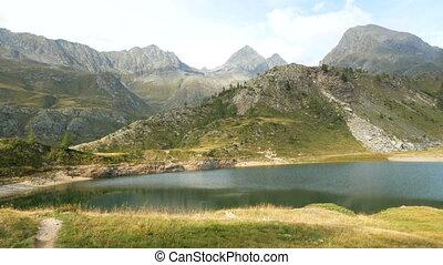 Panoramic view of small alpine lake on the Bergamo Alps