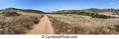 Panoramic view of small dry dusty trails in the valley