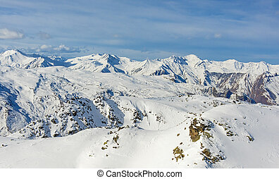 Panoramic view of snowy mountain range in winter