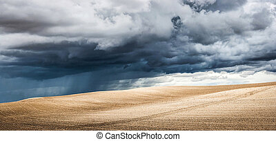 Panoramic view of summer landscape with dramatic thunderclouds in the background