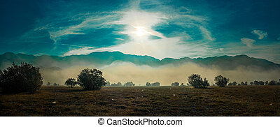 Panoramic view of summer mountain landscape in mist