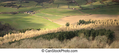Panoramic view of sunlight travelling over the fields