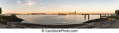 Panoramic view of sunset light over the downtown Seattle, Washington, USA.