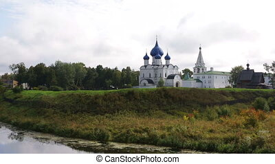 Panoramic view of Suzdal Kremlin and river Kamenka, Golden...