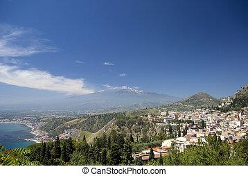 panoramic view of taormina and mt. etna - taormina sicily...