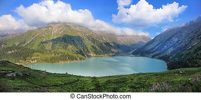 Big Almaty lake surrounded by the Tien Shan mountains