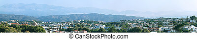 Panoramic view of the city and mountains.