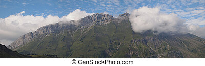 Panoramic view of the cliffs and mountains from the famous Aravis pass, France, The Alps, Panorama
