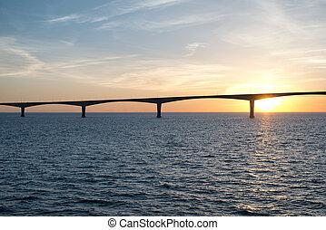 Panoramic view of the Confederation Bridge over sunset sky, Northumberland Strait, Prince Edward Island, Canada