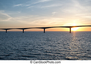 Panoramic view of the Confederation Bridge over sunset sky, Northumberland Strait, Prince Edward Island, Canada