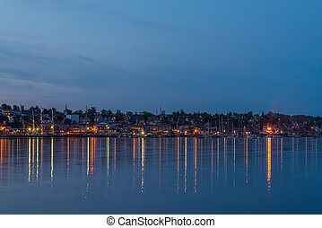 Panoramic view of the famous harbor front of Lunenburg during Tall Ship Festival 2017 at night
