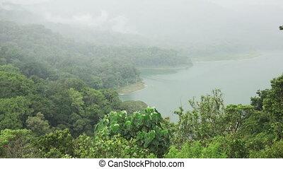 Panoramic view of the Lake Tamblingan in fog of Bali...