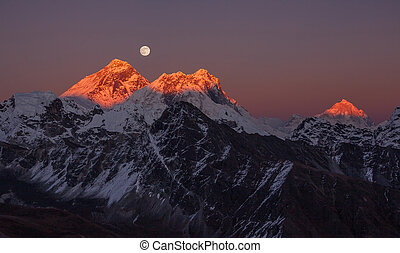 Panoramic view of the Mount Everest (8848 m) and Makalu peak (8485 m) at sunset on a full moon.