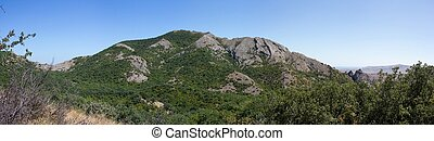 Panoramic view of the mountains in a summer cloudless day.