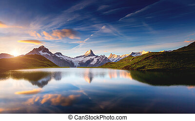 Panoramic view of the Mt. Schreckhorn and Wetterhorn. Location place Bachalpsee in Swiss alps, Grindelwald valley