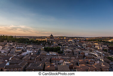 Panoramic view of the old town at sunset in Toledo, Spain.