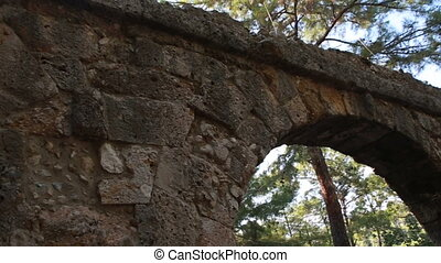 Panoramic view of the ruins of the ancient Greek and Roman aqueduct in Phaselis city