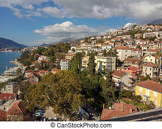 Panoramic view of the town near the sea and mountains