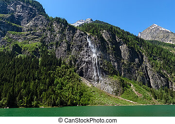 Panoramic view of the waterfall on the Lake Stillup in the Alps, Austria, Tyrol