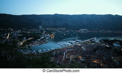 Panoramic view of tourist resort town Kotor with port and...