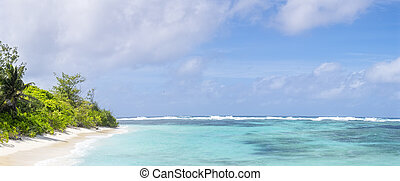 Panoramic view of tropical beach and clean azure water