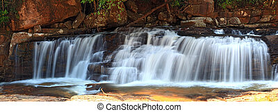 panoramic view of tropical Tadtone waterfall in rain forest ...