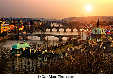 Panoramic view on Charles bridge and sunset Prague lights. ...