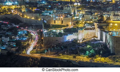 Panoramic view on Jerusalem night timelapse with traffic on the road from the Mount of Olives.