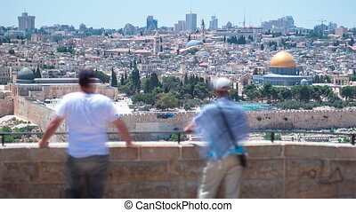 Panoramic view on Jerusalem timelapse with the Dome of the Rock from the Mount of Olives.