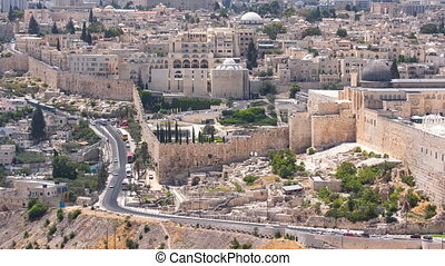 Panoramic view on Jerusalem timelapse with traffic on the road from the Mount of Olives.