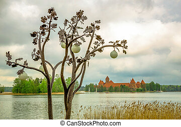 Panoramic view on Medieval old castle in Trakai, Lithuania placed on Galve lake. Island ancient castle are one of the most popular touristic destinations and cultural center in Lithuania.