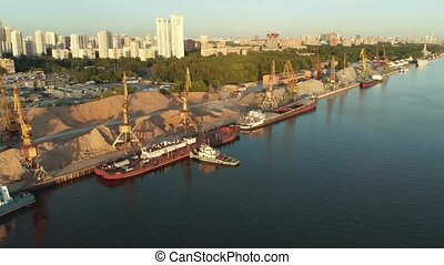 Panoramic view on river port with fleet barges anchored in...