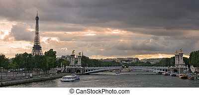 Panoramic view on Seine river, Alexander the III bridge and Eiffel Tower in Paris, France.
