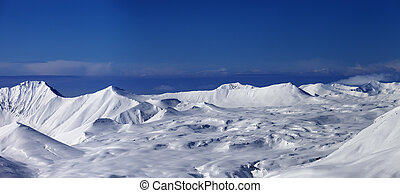 Panoramic view on snowy plateau and blue sky at nice day....