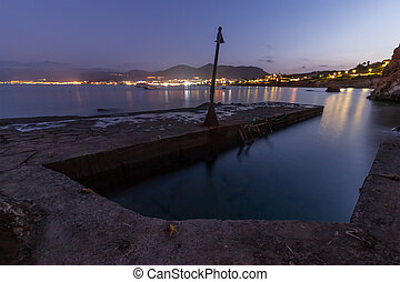 Panoramic view on the beach in Crete in the evening. Long exposure.