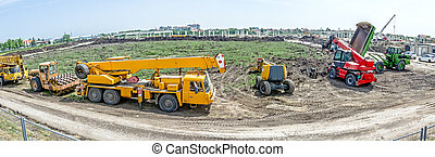 Panoramic view on the group of construction machinery who are parked at building site