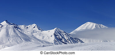 Panoramic view on winter mountains