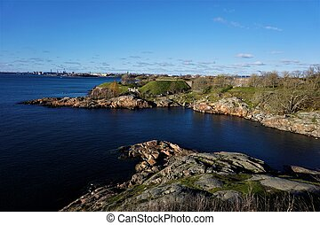 Panoramic view over deep blue baltic sea and island of Suomenlinna to Helsinki
