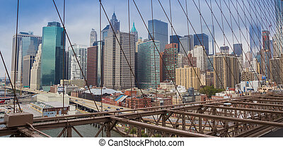 Panoramic view over skyscrapers from the Brooklyn bridge in New York City