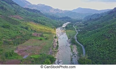 Panoramic View Rocky River near Road between Hilly Landscape