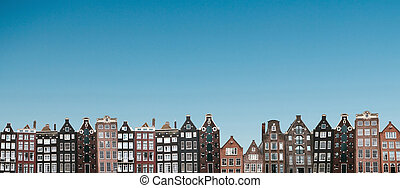 Panoramic view. Traditional houses in Amsterdam in the Netherlands.