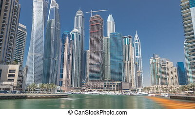 Panoramic view with modern skyscrapers and yachts of Dubai...